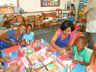 Mom Bambie, Iminathi, Mom Mendiwe and Enzo enjoys making pictures together.